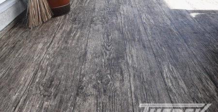 Rustic vinyl plank flooring installed by Tufdek