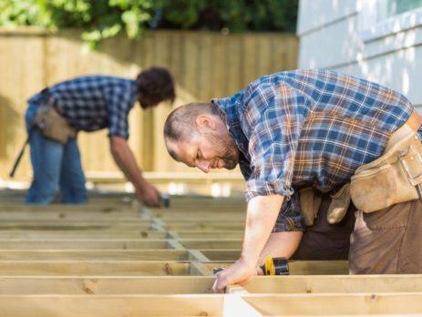 2 carpenters building a new deck