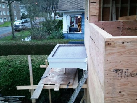 Home under construction with waterproof vinyl flooring on balcony