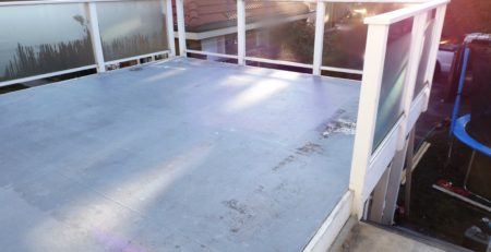 Flat roof deck with damaged flooring