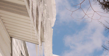 LARGE ICICLES AND SNOW ON ROOF EDGE - TUFDEK
