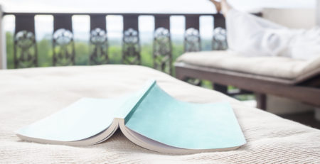 BOOK FACE DOWN ON DECK FURNITURE
