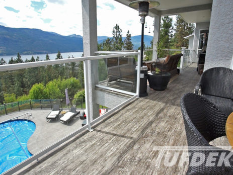 Waterproof vinyl deck with lake view and overlooking a pool