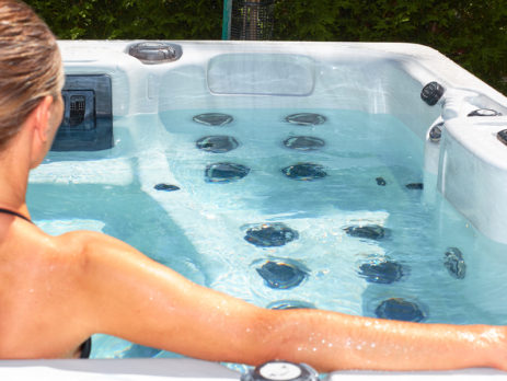 IMAGE OF WOMAN IN HOT TUP - TIPS FOR HOT TUB VINYL DECKING - TUFDEK
