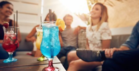 Colorful drinks and people enjoying their deck