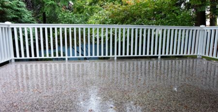 DECK WATERPROOFING - IMAGE OF RAIN SOAKED VINYL DECK FLOORING BY TUFDEK