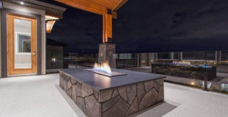 Deck fire pit on a deck newly covered with waterproof vinyl decking by Tufdek