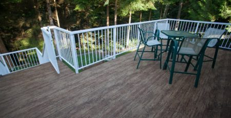 LARGE FINISHED DECK WITH WATERPROOF VINYL PLANK FLOORING BY TUFDEK