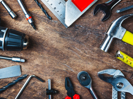 IMAGE OF VARIOUS TOOLS ON WOODEN SURFACE - HIRE A PRO OR DIY A NEW VINYL DECK - TUFDEK