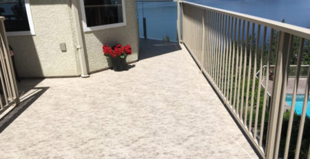 View of a lake from newly resurfaced deck featuring waterproof vinyl decking