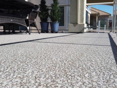 View from deck surface of Designer Aggregate Waterproof Vinyl Decking Installation