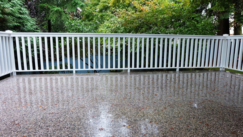 Deck waterproofing - image of rain soaked vinyl deck flooring by Tufdek
