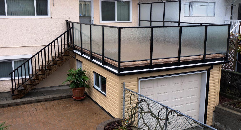 Image of finished garage rooftop vinyl decking by Tufdek