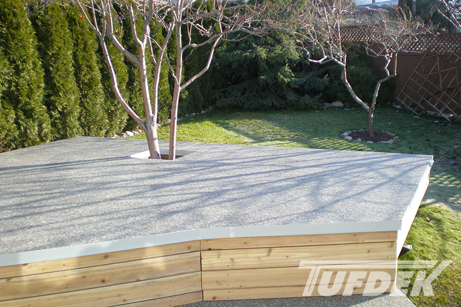 Image of Tufdek vinyl on a deck built around a tree