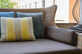 Spring vinyl patio tips - closeup image of patio furniture - Tufdek