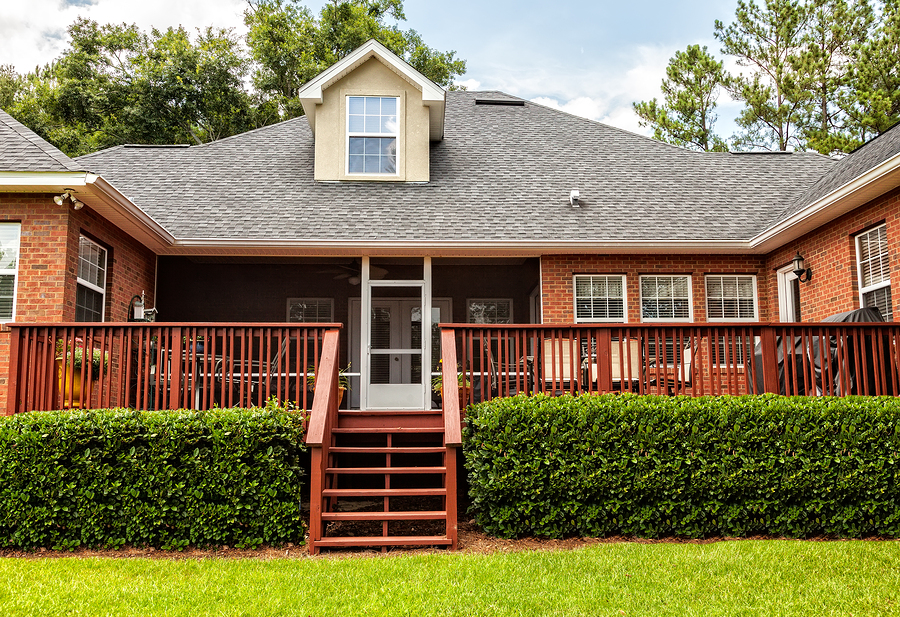 Large backyard deck with stairs to the lawn - Tufdek