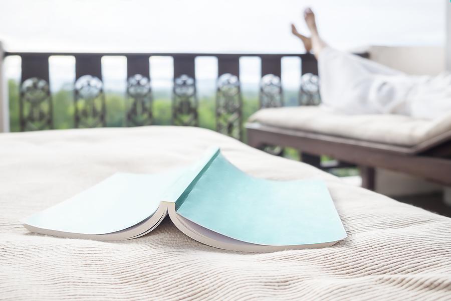Book face down on deck furniture - Tufdek