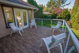 Backyard deck finished in Designer Birch Vinyl Plank Flooring by Tufdek