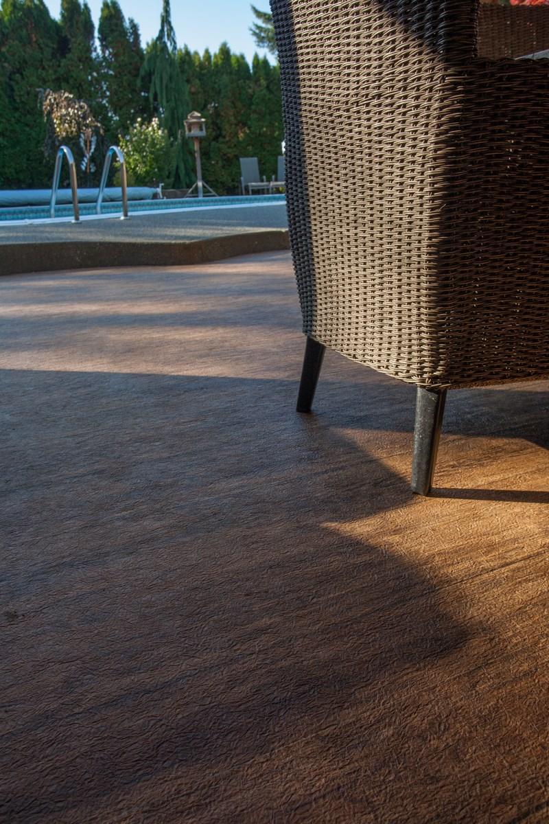 Pool surround finished in waterproof outdoor vinyl flooring by Tufdek