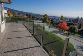 Tufdek vinyl decking installation with vinyl and glass railing